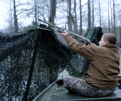 A young duck hunter aims at a flock of duck flying toward him during Marine Corps Logistics Base Albany's annual Youth Duck Hunt, Jan. 16.