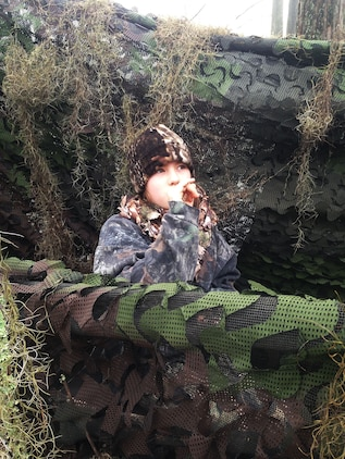 A young duck hunter uses her duck call during Marine Corps Logistics Base Albany's annual Youth Duck Hunt, Jan. 16.