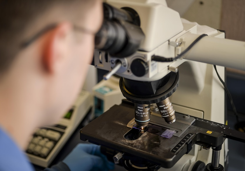 Senior Airman Josef Ansorge, 2nd Medical Support Squadron laboratory technician, uses a microscope to analyze a blood smear slide at Barksdale Air Force Base, La., Jan. 26, 2016. Microscopes used by technicians are flexible and provide multiple levels of magnification assisting in the screening of a variety of different specimens. (U.S. Air Force photo/Airman 1st Class Mozer O. Da Cunha)