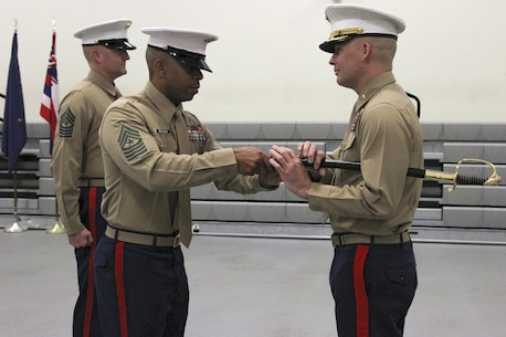 Sgt. Maj. Spencer J. Beacham (center), the outgoing senior enlisted leader of Marine Corps Recruiting Station Orange County, returns the sword of office to Maj. James Dollard, his commanding officer, during a relief and appointment ceremony in Seal Beach, Caif., Jan. 15, 2016. During the ceremony, Beacham, from Dothan, Ala., was awarded a Meritorious Service Medal and relinquished duties to Sgt. Maj. Jason A. Politte.