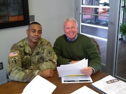 Military Planner Pete Gitto, from USACE Pacific Ocean Division, and Sgt. 1st Class Kenneth Davis, from the 95th Civil Affairs Brigade, partner at the planning workshop for a readiness exercise for the 97th Civil Affairs Battalion.  The team collaborated to integrate the USACE 62nd FEST into a civil affairs mission readiness exercise. (Courtesy photo by 95th Civil Affairs Brigade)