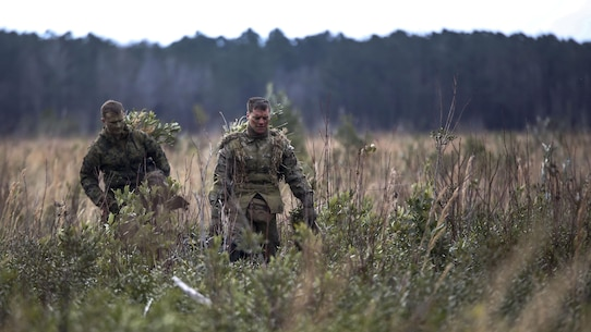 Marine students undergoing the 2nd Marine Division Combat Skills Center's Pre-Scout Sniper Course depart a field following a stalking exercise at Marine Corps Base Camp Lejeune, North Carolina, Jan. 22, 2016. The exercise required students to traverse approximately 1,000 meters of high grass and fire on a target, all without being detected.