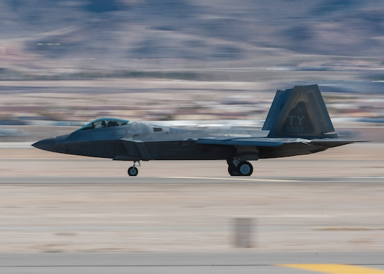 An F-22 Raptor from the 325th Fighter Wing, 95th Fighter Squadron, Tyndall Air Force Base, Fla., takes off from Nellis AFB to participate in a Red Flag 16-1 exercise Jan. 26, 2016. Red Flag is celebrating its 41st anniversary with Red Flag being a realistic combat training exercise involving the air, space and cyber forces of the U.S. and its allies, and is conducted on the vast bombing and gunnery ranges on the Nevada Test and Training Range. (U.S. Air Force photo by Senior Airman Jake Carter)