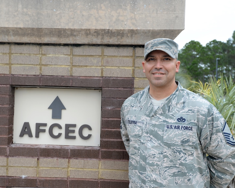 Master Sgt. Christopher Tilstra, AFCEC force development manager, poses next to the entrance of the Air Force Civil Engineer Center. AFCEC provides tools, practices and professional support to maximize Air Force civil engineer capabilities in base and contingency operations. The staff comprises technical and professional experts in a variety of areas including engineering, emergency management, training, pavement analysis, fire protection, explosive ordnance disposal, aircraft arresting systems, computer automation and energy management. (U.S. Air Force photo by Airman 1st Class Cody R. Miller/Released)