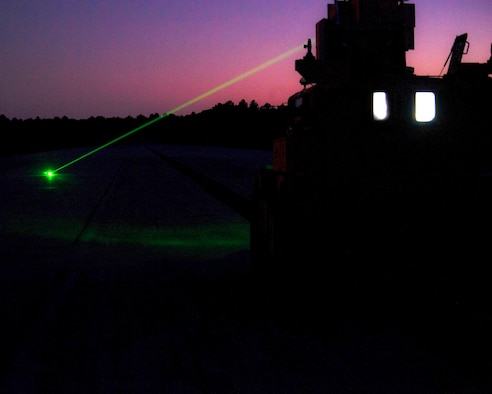 This week's Squadron of the Week is Tyndall's Air Force Civil Engineer Center. An airfield explosive ordnance removal vehicle tests its laser during a demonstration at Tyndall's Silver Flag site, Dec 8.  The vehicle uses a laser to detonate unexploded ordnance on airfields. It is a safer way of disposing hostile bombs when compared to conventional methods.  Developing systems like this is part of the Air Force Civil Engineer Center's mission. Other mission sets include facility investment planning, design and construction, operations support, real property management, readiness, energy support, environmental compliance and restoration, and audit assertions, acquisition and program management. (U.S. Air Force photo by Senior Airman Solomon Cook/Released)