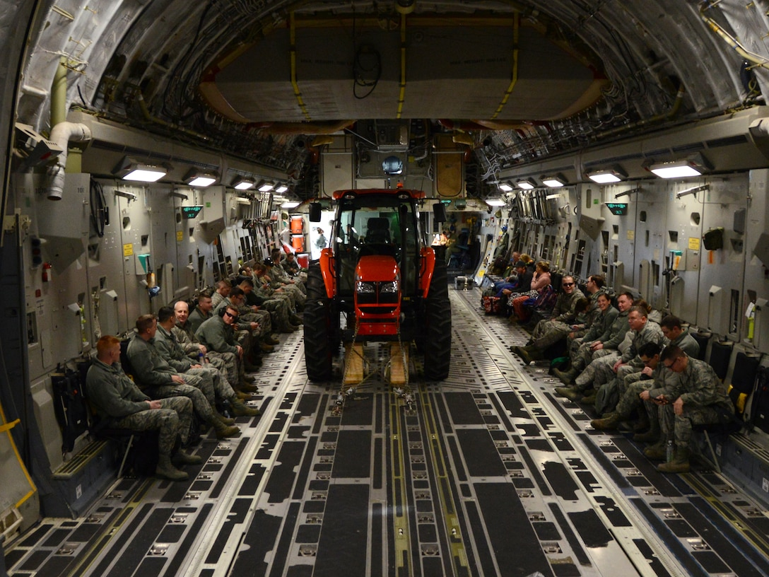 Members of the 30th Aerial Port Squadron prepare to depart for Dobbins Air Reserve Base, G.A., on January 9, 2016 at the Niagara Falls Air Reserve Station. The NFARS members will be performing a training exercise there. (Photo by U.S. Air Force Staff Sgt. Richard Mekkri)