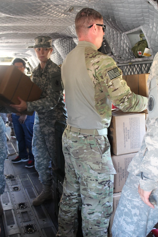 U.S. Army members with Joint Task Force-Bravo unload supplies from a CH-47 Chinook during a medical training exercise Jan. 27, 2016 in Gracias a Dios Department (state), Honduras. The Task Force supported the Honduran medical effort, helping provide the rural population with basic medical care and supplies. (U.S. Army photo by Maria Pinel/ Released)