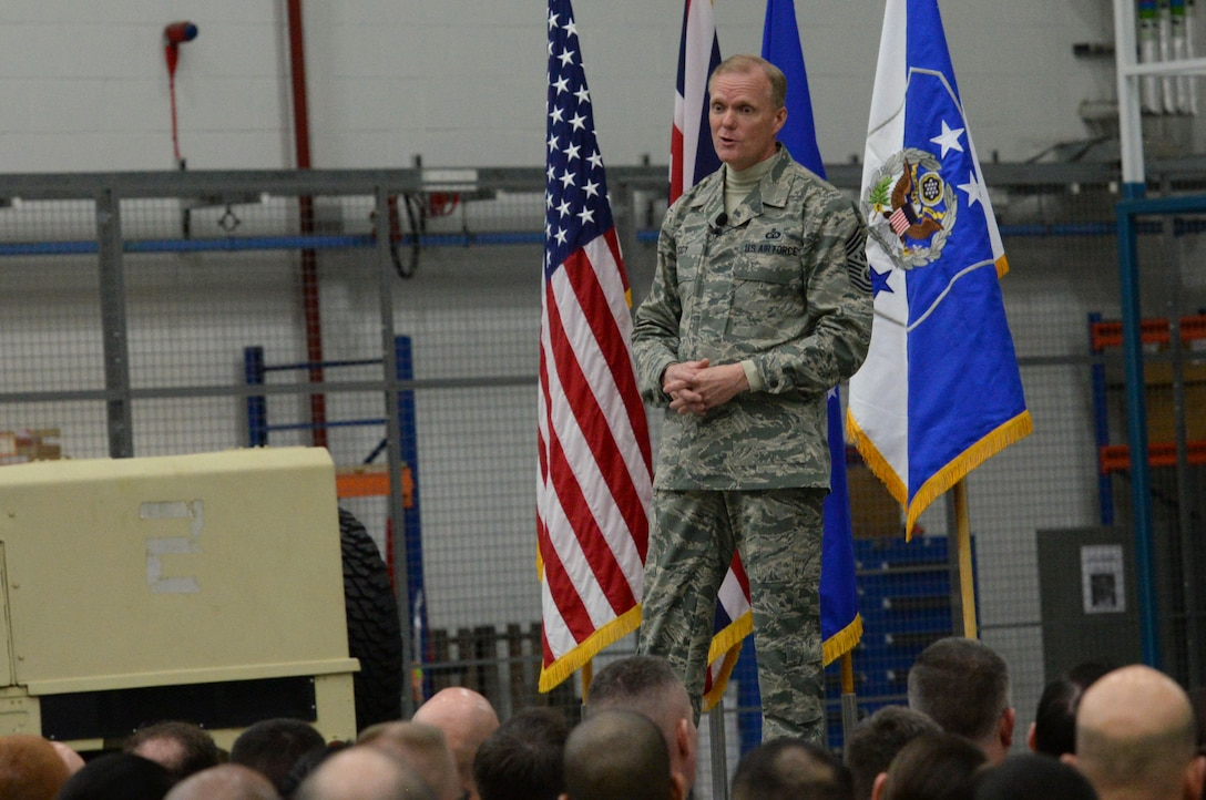 Chief Master Sgt. of the Air Force James Cody speaks to Airmen during an all call Jan. 27, 2016, on RAF Mildenhall, England. Cody addressed the importance of interpersonal relationships and the importance of each Airman's contribution to the mission. (U.S. Air Force photo by Airman 1st Class Justine Rho/Released)