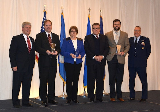 Mr. Thomas Lockhart, Director of the Materials and Manufacturing Directorate, along with Deputy Director Lt. Col. Frederick Hunt and Mr. Michael Cleary, presented the directorate's top award, the Cleary Scientific Achievement Award, to the Multiferroics Team at the 63rd Annual Awards luncheon, held January 22, 2016.  From left to right:  Mr. Thomas Lockhart, Dr. John Jones, Dr. Gail Brown, Mr. Michael Cleary, Dr. Brandon Howe, and Lt. Col. Frederick Hunt.  (U.S. Air Force photo/David Dixon)