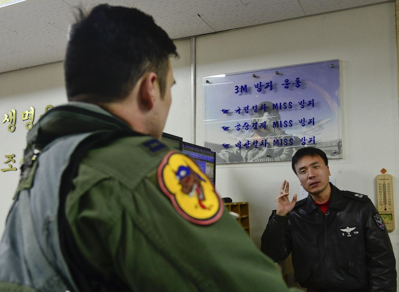 Republic of Korea air force Maj. Jung, Yong Sun (left), 121st Fighter Squadron pilot, speaks with U.S. Air Force Capt. Shannon Beers, 36th Fighter Squadron pilot, after a briefing during Buddy Wing 16-1 at Seosan Air Base, ROK, Jan. 27, 2016. The Buddy Wing exercise is a combined fighter exchange program between the U.S. and ROKAF to promote solidarity and mutual understanding of all executed operations. (U.S. Air Force photo by Senior Airman Kristin High/Released)