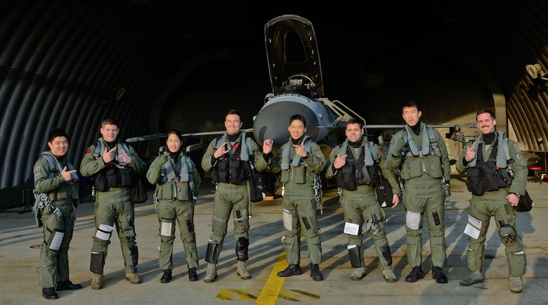 Pilots from the 36th Fighter Squadron, U.S. Air Force, and the 121st Fighter Squadron, Republic of Korea air force, pose for a photo before takeoff during Buddy Wing 16-1 at Seosan Air Base, ROK, Jan. 28, 2016. The exercise, conducted throughout the year, is used to sharpen interoperability between the allied forces. (U.S. Air Force photo by Senior Airman Kristin High/Released)