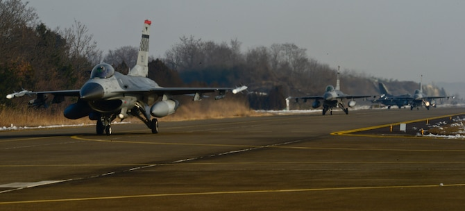 Pilots from the 36th Fighter Squadron, U.S. Air Force taxi to the runway prior to takeoff during Buddy Wing 16-1 at Seosan Air Base, ROK, Jan. 27, 2016. The exercise provided an opportunity for the allied forces to train together and to learn how to communicate better in the event of real-world contingencies. (U.S. Air Force photo by Senior Airman Kristin High/Released)