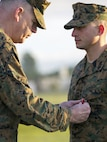 U.S. Marines Corps Maj. Gen. Niel E. Nelson, commander of U.S. Marine Corps Forces Europe and Africa awards Sgt. Matthew A. Sprankle the Navy and Marine Corps Medal, aboard Morón Air Base, Spain, Jan. 26, 2016, after saving a Senegalese man from drowning last August. The award is the highest non-combative decoration for heroism awarded by the U.S. Department of the Navy.  (U.S. Marine Corps photo by Sgt. Kassie L. McDole/Released)