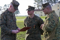 U.S. Marine Corps Maj. Gen. Niel E. Nelson, commander of U.S. Marine Corps Forces Europe and Africa, (left), and Sgt. Maj. William R. Frye, Sergeant Major of U.S. Marine Corps Forces Europe & Africa (right), discuss Sgt. Matthew A. Sprankle, Special-Purpose Marine Air-Ground Task Force Crisis Response-Africa (middle) actions after receiving the Navy and Marine Corps Medal, aboard Morón Air Base, Spain, Jan. 26, 2016, for saving a Senegalese man from drowning last August. The award is the highest non-combative decoration for heroism awarded by the U.S. Department of the Navy.  (U.S. Marine Corps photo by Sgt. Kassie L. McDole/Released)