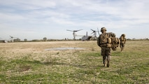U.S. Marines with the Ground Combat Element, Special-Purpose Marine Air-Ground Task Force Crisis Response-Africa, run toward an MV-22B Osprey after recovering a simulated casualty during an alert-force drill at Naval Station Rota, Spain, January 23, 2016. SPMAGTF-CR-AF is a self-sustaining crisis-response force prepared for the protection of American personnel and facilities on the African continent when directed.