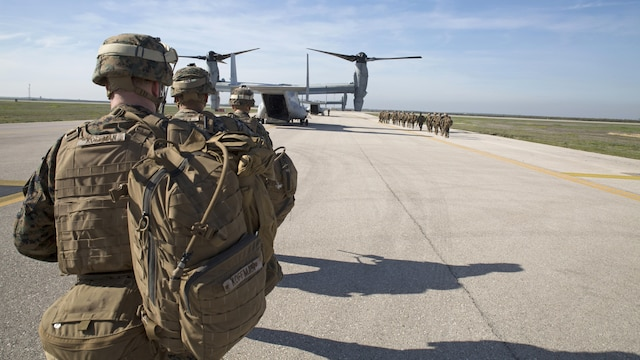 U.S. Marines with the Ground Combat Element, Special-Purpose Marine Air-Ground Task Force Crisis Response-Africa, prepare to board an MV-22B Osprey during an alert drill at Morón Air Base, Spain, Jan. 23, 2016. SPMAGTF-CR-AF's crisis response capability requires Marines to be ready to respond within six hours of an alert in support of U.S. Africa Command.