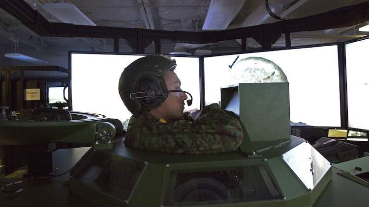 Japan Ground Self-Defense Force Cpl. Ishida, with the Western Army Infantry Regiment, looks out from the gun turret onto a simulated desert after successfully engaging targets during Exercise Iron Fist 2016 at Marine Corps Base Camp Pendleton, California, Jan. 26. The amphibious assault vehicle simulator offers the unique ability to train hands-on with the controls without requiring the resources needed to conduct training in the field. Iron Fist is an annual, bilateral amphibious assault exercise focused on strengthening of amphibious operations between the U.S. Marine Corps and the JGSDF.