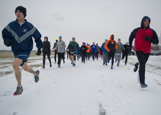 Employees of the National Air and Space Intelligence Center take off from the start line during the unit's 3rd annual Polar Bear Run Friday, Jan. 22, 2016 on the base's flightline running trail. This is NASIC's third annual Polar Bear Run. The Center's Enlisted Advisory Council sponsors the fundraiser run which uses the money for special events. (U.S. Air Force photo by Senior Airman Justyn Freeman)