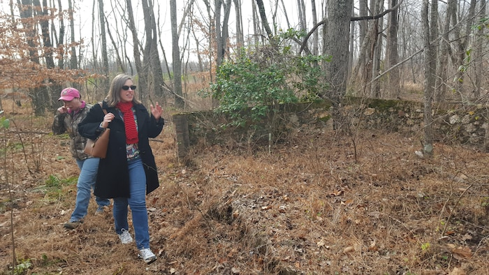 Alicia Osgood visits the ruins of her great-great-great grandparents' house, Landsdown, on Dec. 21, 2015. Osgood searched for the location of her family's house and cemetery for five years.