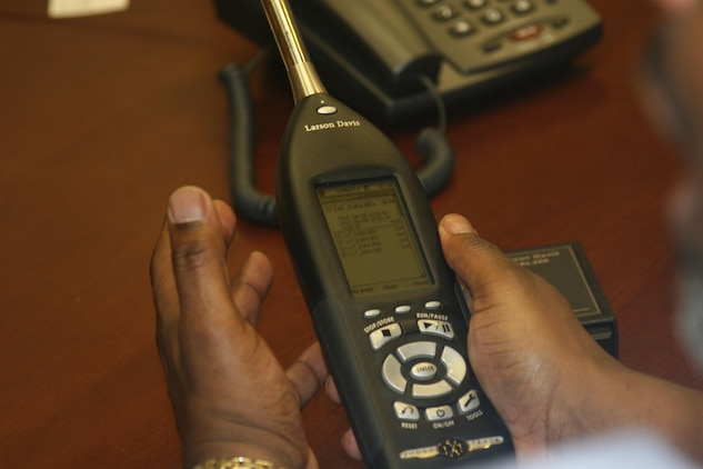 Bernard Truesdale, direct sales representative for Larson Davis, holds the Sound­Expert LxT, a sound level meter that he showed to the Hearing Conservation Task Force at a Jan. 12 meeting. The task force is looking to purchase a device to measure impulse noise from weapons firing.
