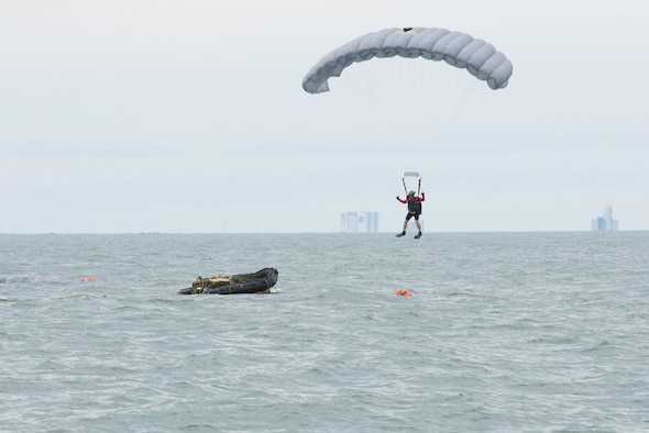 An Air Force Reserve pararescueman descends into the Atlantic Ocean from a C-17 Globemaster III in an effort to recover a NASA astronaut as part of an exercise Jan. 14, 2016, off the shore of Cape Canaveral Air Force Station, Fla. The 45th Operations Group's Detachment 3 joined NASA's Commercial Crew Program; Air Force pararescuemen; combat rescue officers; and survival, evasion, resistance and escape specialists to practice recovering astronauts quickly and safely in the event they would need to abort their spacecraft. (U.S Air Force photo/Matthew Jurgens)