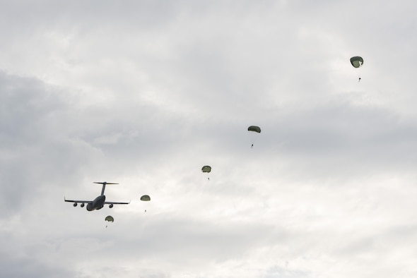 A C-17 Globemaster III from the Alaska Air National Guard's 249th Airlift Squadron drops off paratroopers and equipment as part of an astronaut rescue exercise in the Atlantic Ocean near Cape Canaveral Air Force Station, Fla., Jan. 14, 2016. The 45th Operations Group's Detachment 3 joined NASA's Commercial Crew Program; Air Force Reserve pararescuemen; combat rescue officers; and survival, evasion, resistance and escape specialists to practice recovering astronauts quickly and safely in the event they would need to abort their spacecraft. (U.S Air Force photo/Matthew Jurgens)