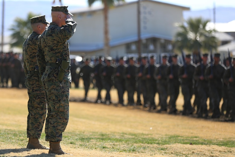 Col. Jay M. Bargeron, former commanding officer, 7th Marine Regiment and Col. William H. Vivian, commanding officer, 7th Marine Regiment, salute Marines and sailors performing a pass-in-review during the regiment's change of command ceremony at Lance Cpl. Torrey L. Gray Field, Dec. 18, 2015. (Official Marine Corps photo by Cpl. Medina Ayala-Lo/Released)
