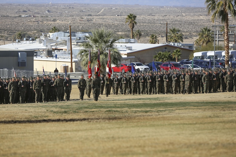 Marines and sailors of 7th Marine Regiment stand in formation during the 7th Marine Regiment change of command ceremony at Lance Cpl. Torrey L. Gray Field, Dec. 18, 2015. (Official Marine Corps photo by Cpl. Medina Ayala-Lo/Released)