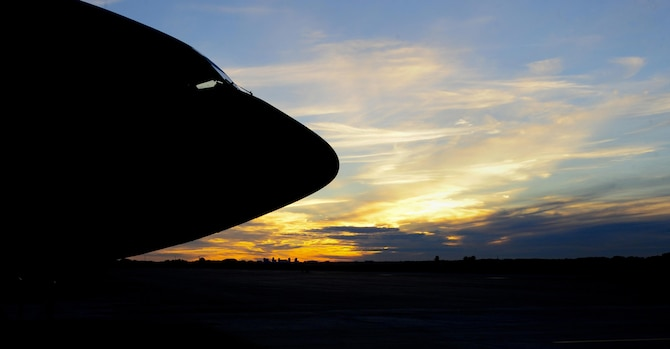 A KC-135 Stratotanker sits on the flightline at MacDill Air Force Base, Fla., as the sun sets over St. Petersburg, Fla., Jan. 12, 2016. The 16 KC-135s currently assigned to MacDill AFB provide aerial refueling to nine combatant commands. (U.S. Air force photo/Airman 1st Class Mariette M. Adams)