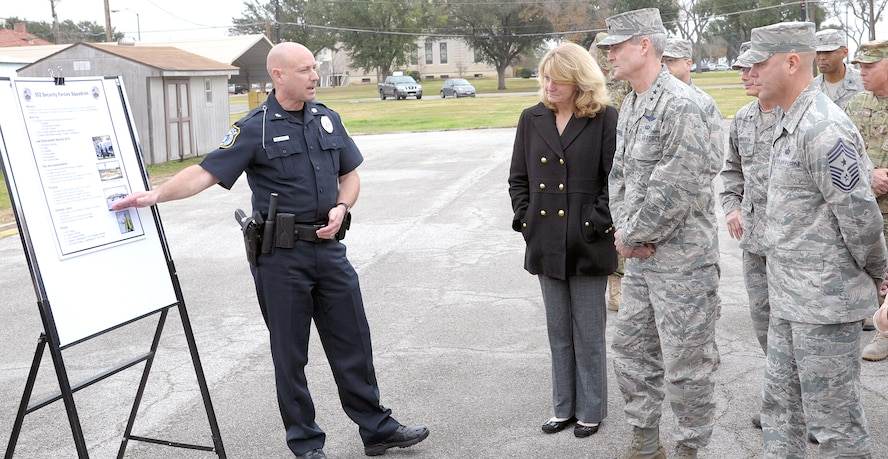 Bryan Gillespie (left), 502nd Security Forces Squadron director, briefs Lt. Gen. Darryl Roberson, commander of Air Education and Training Command, his wife, Cheryl; and Chief Master Sergeant David R. Staton, AETC command chief master sergeant, on the 502nd SFS mission Jan. 20 at Joint Base San Antonio-Fort Sam Houston's Base Defense Operations Center.
