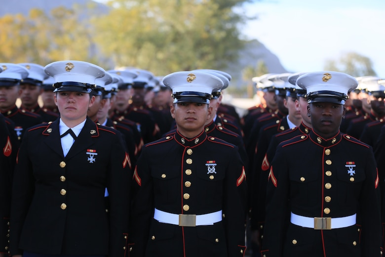 Marine Corps Communication-Electronics School students prepare to march during the Career Builder Challenge Military Appreciation Ceremony at the Tom Weiskopf Private Course located in the Professional Golfers Association of America Course West in La Quinta, Calif., Jan. 23, 2016. More than 50 MCCES Marines marched in formation during the event. (Official Marine Corps photo by Cpl. Julio McGraw/Released)