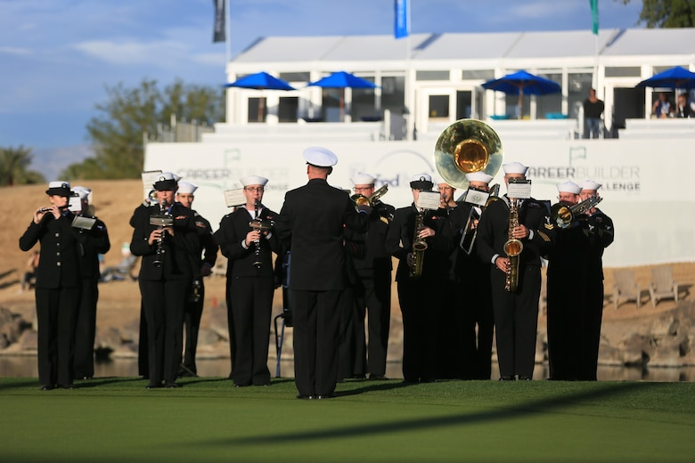 Navy Band Southwest plays renditions of patriotic music during the Career Builder Challenge Military Appreciation Ceremony at the Tom Weiskopf Private Course located in the Professional Golfers Association of America Course West in La Quinta, Calif., Jan. 23, 2016. (Official Marine Corps photo by Cpl. Julio McGraw/Released)