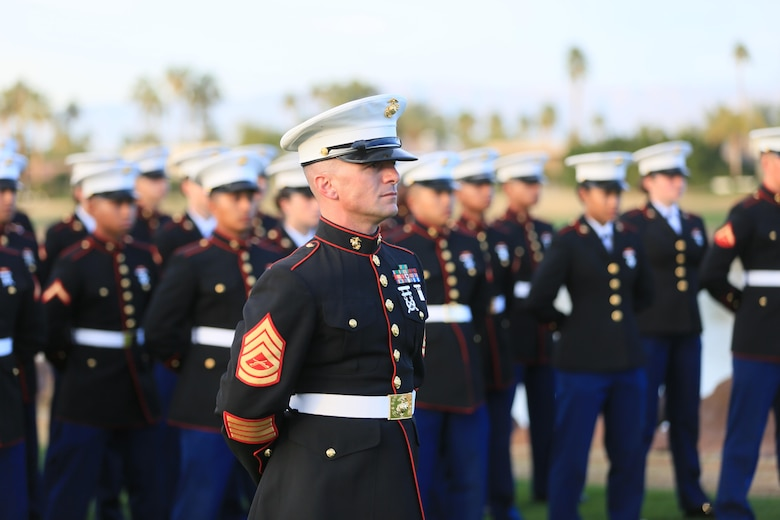 Gunnery Sgt. Antonio Soto, company first sergeant, Marine Corps Communication-Electronics School, stands at parade rest with his formation of more than 50 MCCES students during the Career Builder Challenge Military Appreciation Ceremony at the Tom Weiskopf Private Course located in the Professional Golfers Association of America Course West in La Quinta, Calif., Jan. 23, 2016. (Official Marine Corps Photo by Cpl. Julio McGraw/Released)