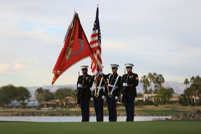 The 3rd Light Armored Reconnaissance Battalion Color Guard presents the national colors during the playing of 'The Star-Spangled Banner' during the Career Builder Challenge Military Appreciation Ceremony at the Tom Weiskopf Private Course located in the Professional Golfers Association of America Course West in La Quinta, Calif., Jan. 23, 2016. (Official Marine Corps photo by Cpl. Julio McGraw/Released)