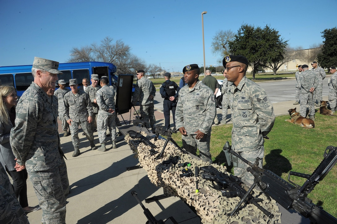 Senior Airman Reshawn Hill (left) and Technical Sgt. Jermaine, 802nd Security Forces Squadron security forces specialists, briefs Lt. Gen. Darryl Roberson, Commander of Air Education and Training Command, on the different weapons systems they employ at the 802nd SFS Jan. 21, Joint Base San Antonio-Lackland.  Roberson was provided a 502nd Air Base Wing immersion tour where he visited units throughout JBSA-Randolph, Lackland and Fort Sam Houston, Jan. 20-22.  The 502nd ABW is responsible for installation support across all JBSA locations.  (U.S. Air Force photo by Joel Martinez)