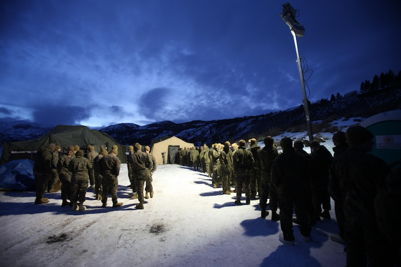 Hundreds of Marines wait to enter the field mess tent for hot food during cold weather training at the Marine Corps Mountain Warfare Training Center, Calif., Jan. 10, 2015. Hundreds of Marines participated in the cold weather training, enduring freezing temperatures during the two-week-long exercise in the Sierra Mountains. (U.S. Marine Corps photo by Cpl. Jason Jimenez/Released)