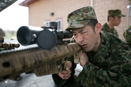 Japan Ground Self Defense Force (JGSDF) Sgt. Yoichi Nasu sights-in with the special application scope rifle during a static display for Exercise Iron Fist 2016 aboard Camp Pendleton, Calif., Jan. 27. The static display was set up to show the capabilities of varying optics. (U.S. Marine Corps photo by Cpl. Xzavior T. McNeal/Released)