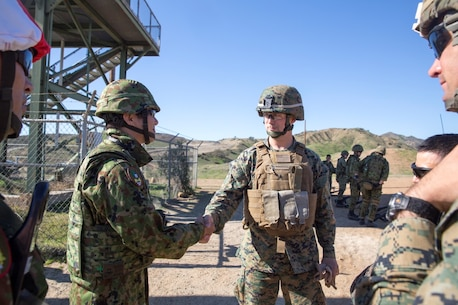 Maj. Tomotake Nagamura (left), company commander with Western Army Infantry Regiment, shakes the hand of Lt. Col. Eric J. Dougherty, commanding officer of 1st Battalion, 4th Marine Regiment at Range 223B, aboard Marine Corps Base Camp Pendleton, Calif., Jan. 25, 2016. Marines with Dougherty's battalion facilitated the use of the range, both allowing the soldiers of Nagamura's unit to practice their skills in an unfamiliar training environment as well as share tactics and skills with their U.S. counterparts.