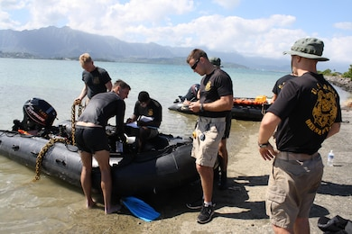 MARINE CORPS BASE HAWAII (Jan. 26, 2016) -- Divers from the  U.S. Army's 7th Dive Detachment ready their dive gear and rib boat before heading out into the waters of Kaneohe Bay to conduct a dive survey for the U.S. Army Corps of Engineers, Honolulu District in support of a Navy Dept. financed structural study of the historic Seaplane Ramps at Marine Corps Base Hawaii (MCBH) on Kaneohe Bay. The study, being conducted in-house by the District, provided an opportunity for the Corps to partner with the Army's 7th Dive Detachment, 65th Engineer Battalion, 130th Engineer Brigade, which conducted the two day underwater site survey this week.