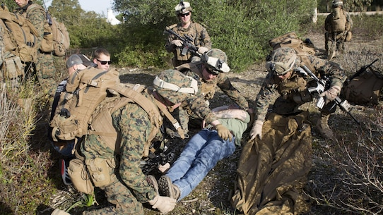 U.S. Marines with Special-Purpose Marine Air-Ground Task Force Crisis Response-Africa prepare to lift a simulated casualty onto a field litter during quick-response training at Naval Station Rota, Spain, January 23, 2016. SPMAGTF-CR-AF is a self-sustaining crisis response force prepared for the protection of American personnel and facilities on the African continent when directed.