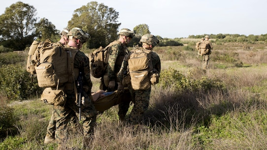 U.S. Marines with Special-Purpose Marine Air-Ground Task Force Crisis Response-Africa extract a simulated casualty during quick-response training at Naval Station Rota, Spain, January 23, 2016. The alert force tested the unit's capabilities by simulating the procedures of reacting to a time-constrained, crisis-response mission.