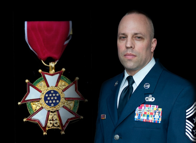 Chief Master Sgt. Mark A. Thomas, 70th Intelligence, Surveillance and Reconnaissance Wing command chief, was presented the Legion of Merit for his excellent leadership at Fort George G. Meade, Maryland January 8, 2016. (U.S. Air Force Illustration by Staff Sgt. Alex Montes)