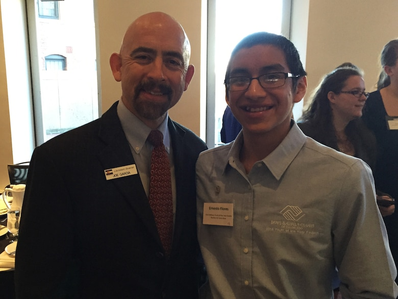 Ernesto Flores, Buckley Air Force Base Youth of the Year, Colo., stands beside Joe Garcia, Lieutenant Governor of Colorado, during a Youth of the Year event, March 24, 2015. The program recognized outstanding teens in the community who embody academic excellence, healthy lifestyles, values of leadership and service to the community. (courtesy photo)