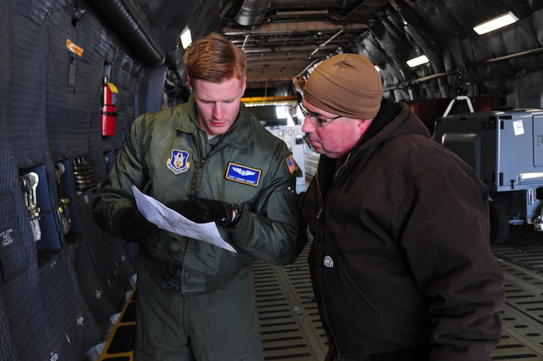 U.S. Air Force Staff Sgt. Conner Cooney, a 709th Airlift Control Squadron loadmaster, left, and Tech. Sgt. Robert Nakoneczny, a 442d Maintenance Squadron aerospace ground equipment mechanic, discuss load plans before uploading equipment onto a C-5 Galaxy aircraft at Whiteman Air Force Base, Mo., Jan. 25, 2016. The cargo contains munitions to load onto 442d Fighter Wing A-10 Thunderbolt II aircraft during a multi-week combat, search and rescue exercise at Patrick AFB, Fla. (U.S. Air Force photo by Senior Airman Keenan Berry)