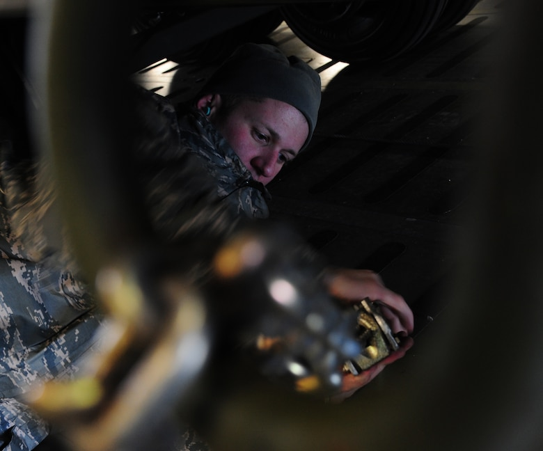 U.S. Air Force Tech. Sgt. Ryan Harrison, a 709th Airlift Control Squadron (ACS) loadmaster, secures cargo on a C-5 Galaxy aircraft at Whiteman Air Force Base, Mo., Jan. 25, 2016. Members of the 709th ACS transported equipment to Patrick AFB, Fla., to provide maintenance support for the 442d Fighter Wing A-10 Thunderbolt II during a multi-week combat search and rescue exercise. (U.S. Air Force photo by Senior Airman Keenan Berry)