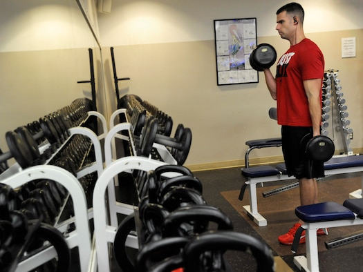 Oregon Air National Guard Tech. Sgt. Thomas Sorensen, an accounting technician assigned to the 142nd Fighter Wing Comptroller Flight, begins his duty day lifting weights at the base gym, Jan. 28, 2016, Portland Air National Guard Base, Ore. The 142nd Fighter Wing began 2016 with a new series of courses and activities under the Comprehensive Airmen Fitness program, designed to focus on Airmen and their families' physical, social, mental and spiritual wellness. (U.S. Air National Guard photo by Tech. Sgt. John Hughel, 142nd Fighter Wing Public Affairs/released)