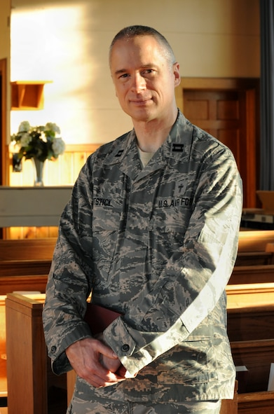 Oregon Air National Guard Chaplain (Capt.) Rory Pitstick, assigned to the 142nd Fighter Wing, pauses for a photograph at the base chapel following Catholic Mass, Jan. 10, 2016. Pitstick is part of the 142nd Fighter Wing's new emphasis of courses and activities under the Comprehensive Airmen Fitness program, designed to focus on Airmen and their families' physical, social, mental and spiritual wellness. (U.S. Air National Guard photo by Tech. Sgt. John Hughel, 142nd Fighter Wing Public Affairs/released)