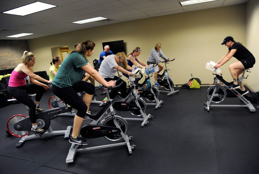Oregon Air National Guard Senior Master Sgt. Bobbi Kennedy, a health service technician assigned to the 142nd Fighter Wing Medical Group, right, teaches a morning spin class at the base gym, Jan. 28, 2016, Portland Air National Guard Base, Ore. The 142nd Fighter Wing began 2016 with a new series of courses and activities under the Comprehensive Airmen Fitness program, designed to focus on Airmen and their families' physical, social, mental and spiritual wellness. (U.S. Air National Guard photo by Tech. Sgt. John Hughel, 142nd Fighter Wing Public Affairs/released)