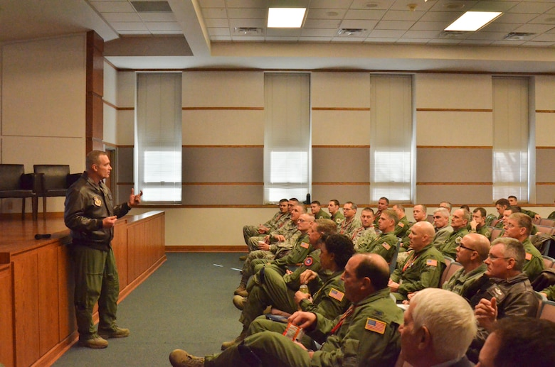 U.S. Air Force Col. Bobby Oates, commander of the Advanced Airlift Tactics Training Center, speaks to guests at the center's 34th annual symposium at Rosecrans Air National Guard Base, St. Joseph, Mo., Jan. 28, 2015. Over 300 Airmen who specialize in airlift tactics from the regular Air Force, Air Force Reserves, and Air National Guard attended the symposium. (U.S. Air National Guard photo by Tech. Sgt. Erin Hickok/Released)