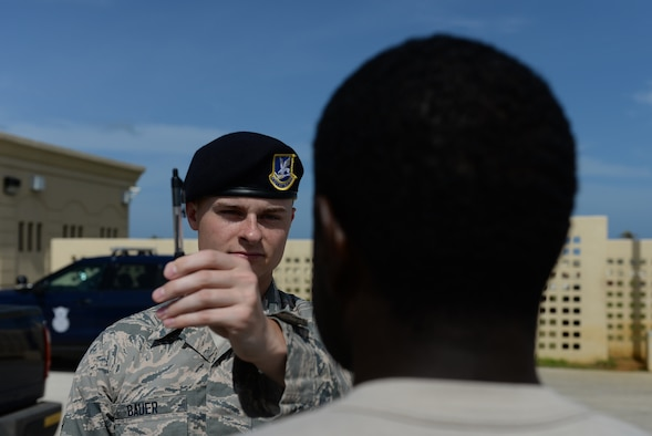 Airman Austin Bauer, 36th Security Forces Squadron, left, conducts a horizontal gaze nystagmus test during field sobriety test training Jan. 29, 2016, at Andersen Air Force Base, Guam. Security Forces members practiced conducting sobriety tests to include the one-leg stand, walk and turn, and horizontal gaze nystagmus test as part of their field sobriety test training. (U.S. Air Force photo/Airman 1st Class Jacob Skovo)